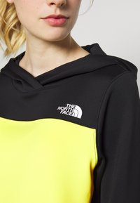 The North Face - WOMENS ACTIVE TRAIL SPACER - Sports shirt - black/lemon - 6