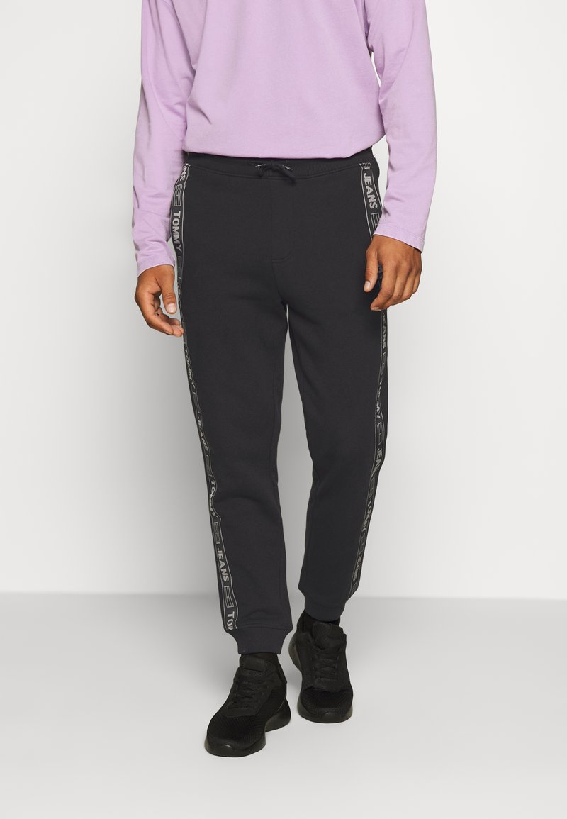 Tommy Jeans - TAPE  - Pantalon de survêtement - black