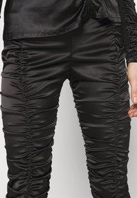 Weekday - SMOCK TROUSER - Pantalones - black - 4