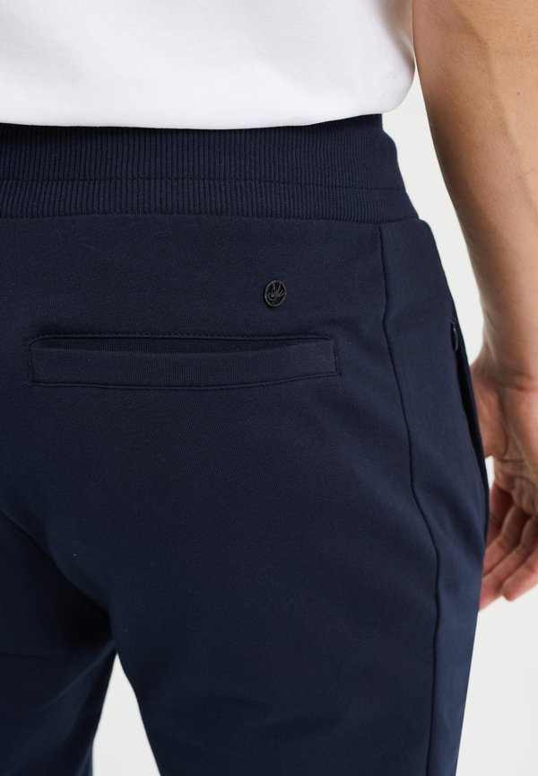WE Fashion Spodnie treningowe - dark blue/granatowy Odzież Męska NXKE