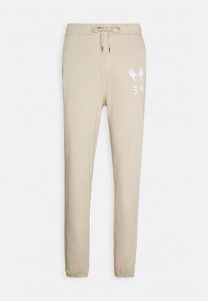 STANLEY UNISEX  - Tracksuit bottoms - beige
