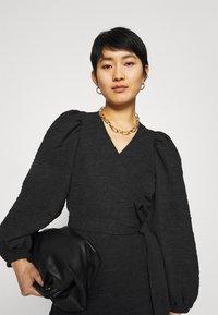 JUST FEMALE - TODA WRAP DRESS - Day dress - black - 4