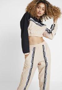 adidas Originals - TRACK PANTS - Trousers - ash pearl - 3