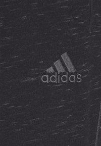 adidas Performance - Tracksuit bottoms - black melange - 5