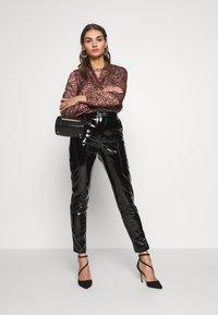 NA-KD - PATENT PANTS - Trousers - black - 1
