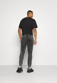 Zign - UNISEX - Tracksuit bottoms - black - 2
