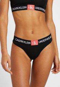 Calvin Klein Underwear - MONOGRAM THONG - Thong - black/aurelie - 0
