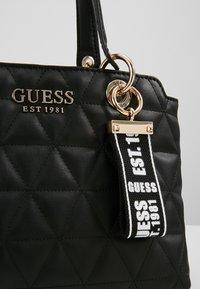 Guess - LAIKEN SMALL SATCHEL - Handbag - black - 6
