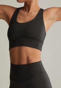 OYSHO - WITH CROSSOVER BACK - Sports bra - dark grey - 4