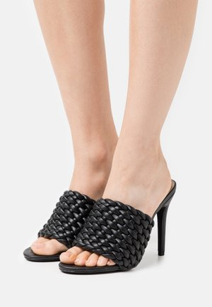 TANYA - Heeled mules - black