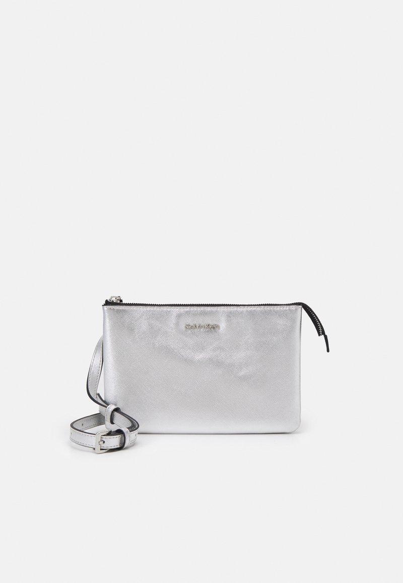 Calvin Klein - DOUBLE COMPARTMENT BODY  - Across body bag - silver