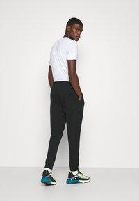 Nike Sportswear - MODERN  - Träningsbyxor - black - 2