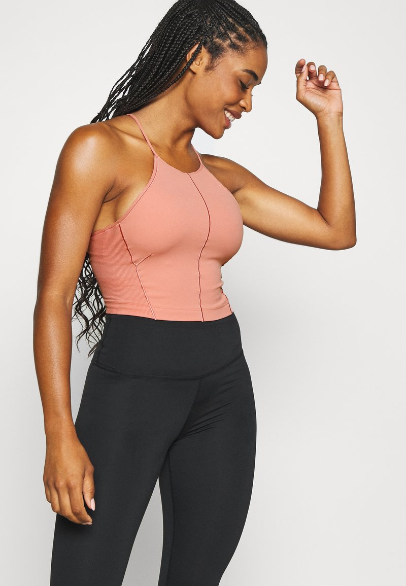 Nike Performance - YOGA CROP TANK - Sports shirt - rust pink/particle beige