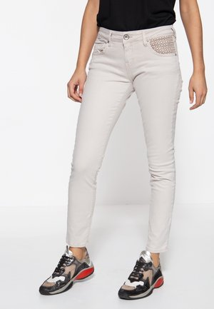 Jeansy Slim Fit - beige