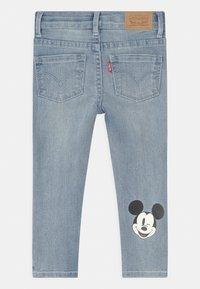 Levi's® - MICKEY MOUSE 710 SUPER SKINNY  - Jeans Skinny Fit - light-blue denim - 1