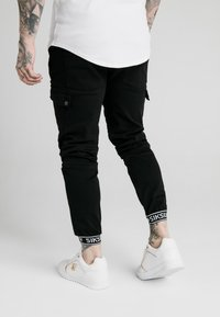 SIKSILK - CUFF PANTS - Cargo trousers - black - 2