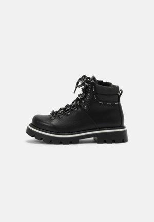 UNISEX - Lace-up ankle boots - black