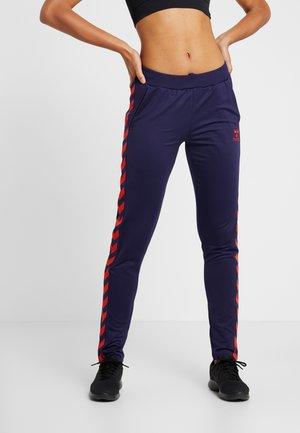 NELLY PANTS - Tracksuit bottoms - purple