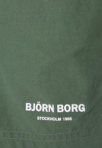 Björn Borg - TRAINING - Sports shorts - duck green - 2