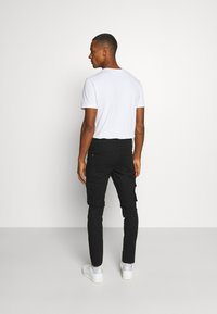 RETHINK Status - PANTS - Cargo trousers - black - 2