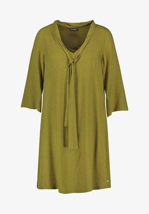 MIT SCHLUPPE - Day dress - avocado green