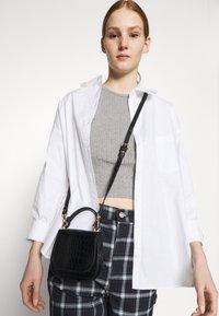 Monki - MEJA FANCY SHIRT - Button-down blouse - white solid - 3