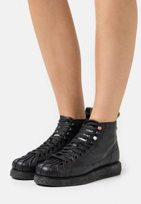 adidas Originals - SUPERSTAR LUXE  - Lace-up ankle boots - core black/shock green - 3
