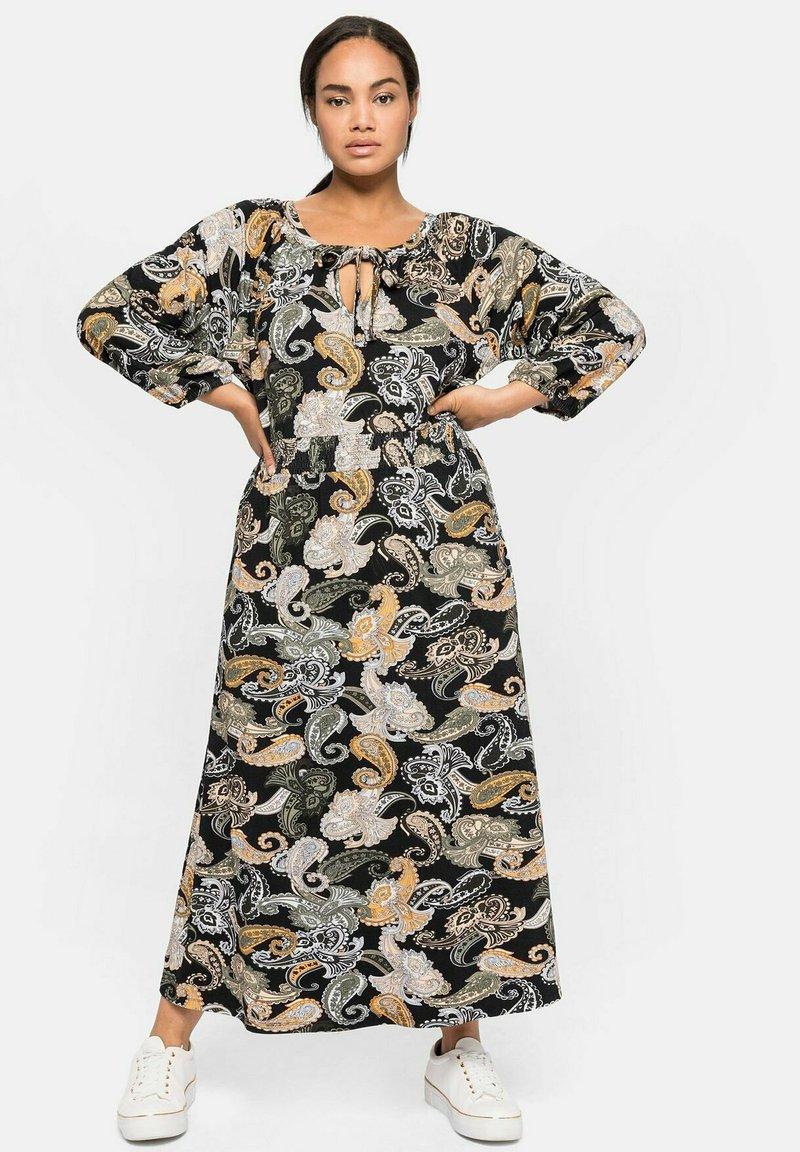 Sheego - Maxi dress - schwarz gemustert