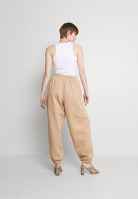 Missguided - SIGNATURE 90S - Tracksuit bottoms - brown - 2