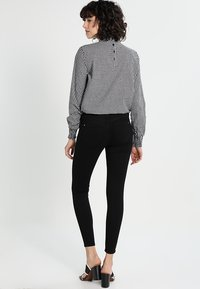 River Island - MOLLY  - Slim fit jeans - black - 2