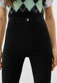 Bershka - SUPER HIGH WAIST - Slim fit jeans - black - 3