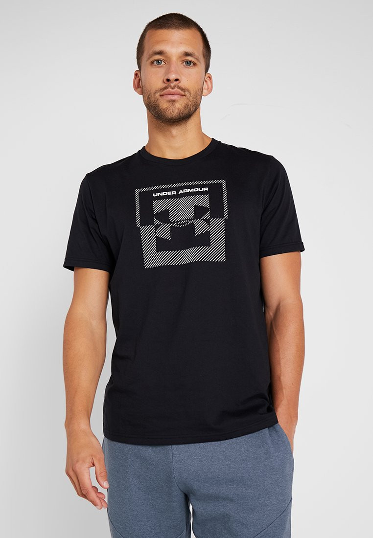 Under Armour - INVERSE BOX LOGO - T-shirt con stampa - black