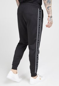 SIKSILK - FITTED PANEL TAPE TRACK PANTS - Tracksuit bottoms - black - 4
