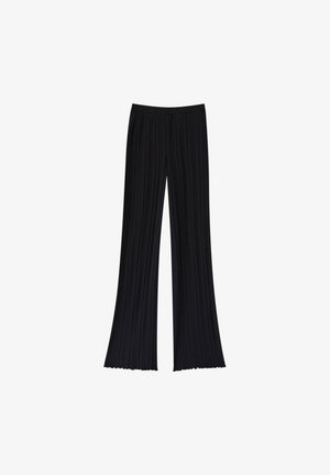 GERIPPTE - Trousers - black