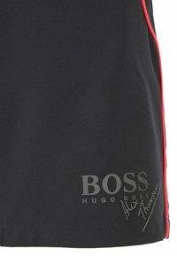 BOSS - Swimming shorts - black - 4