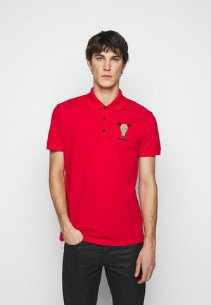 REGULAR - Polo shirt - red