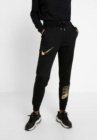 Nike Sportswear - SHINE - Tracksuit bottoms - black/metallic - 0
