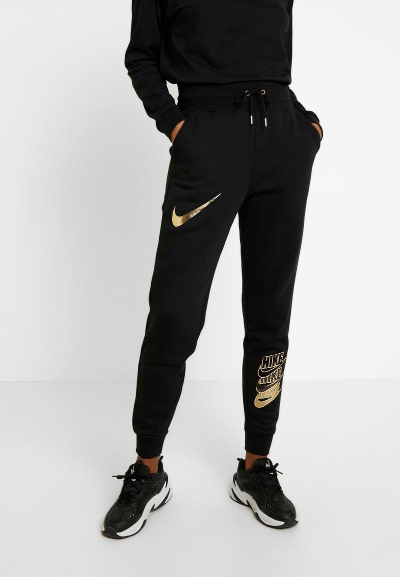 Nike Sportswear - SHINE - Tracksuit bottoms - black/metallic