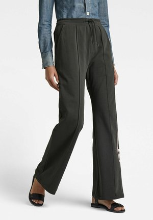 STRIPE RAW FLARED - Tracksuit bottoms - raven