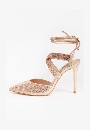 GLOWY STRASS - Lace-up heels - beige