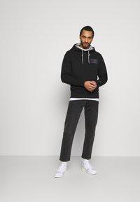 Tommy Jeans - ESSENTIAL HOODIE UNISEX - Sweatshirt - black - 1