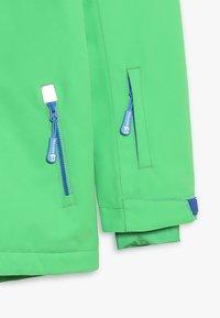 TrollKids - KIDS HOLMENKOLLEN SNOW JACKET PRO - Snowboard jacket - bright green - 4