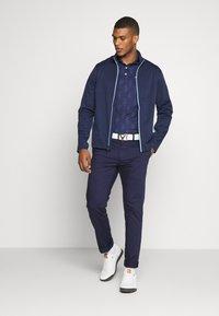 Polo Ralph Lauren Golf - STRATUS UNLINED JACKET - Vodotěsná bunda - french navy/powder blue - 1