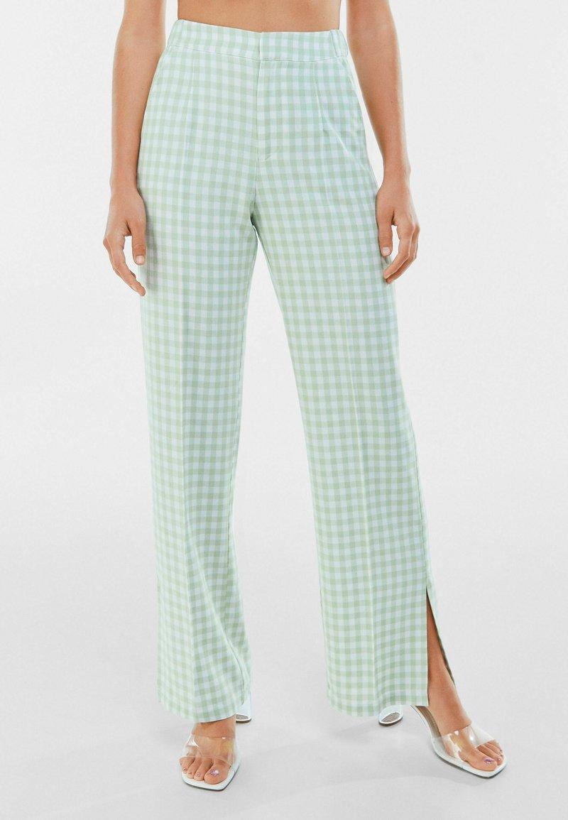 Bershka - Trousers - green