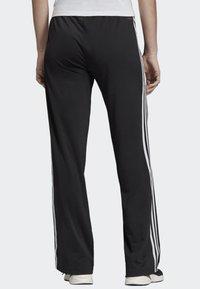 adidas Performance - DESIGNED 2 MOVE 3-STRIPES JOGGERS - Tracksuit bottoms - black - 1